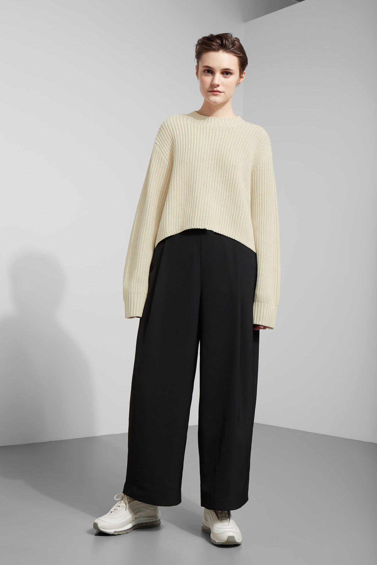 Model side image of Weekday mahal sweater in beige