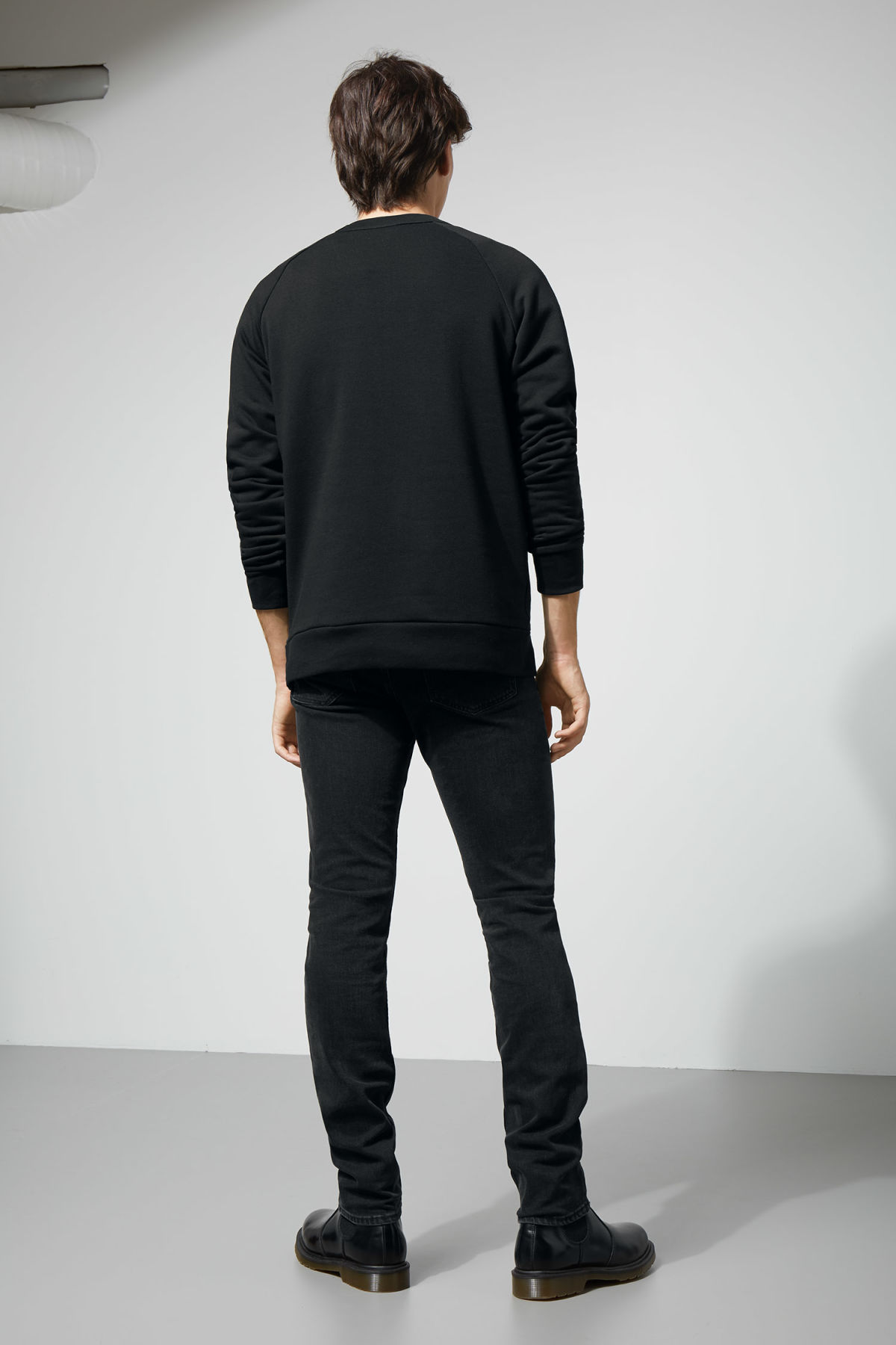 Model side image of Weekday jaxon sweatshirt  in black