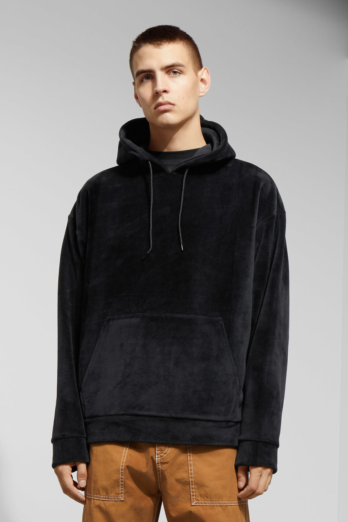 Model front image of Weekday big hawk velvet hoodie in black