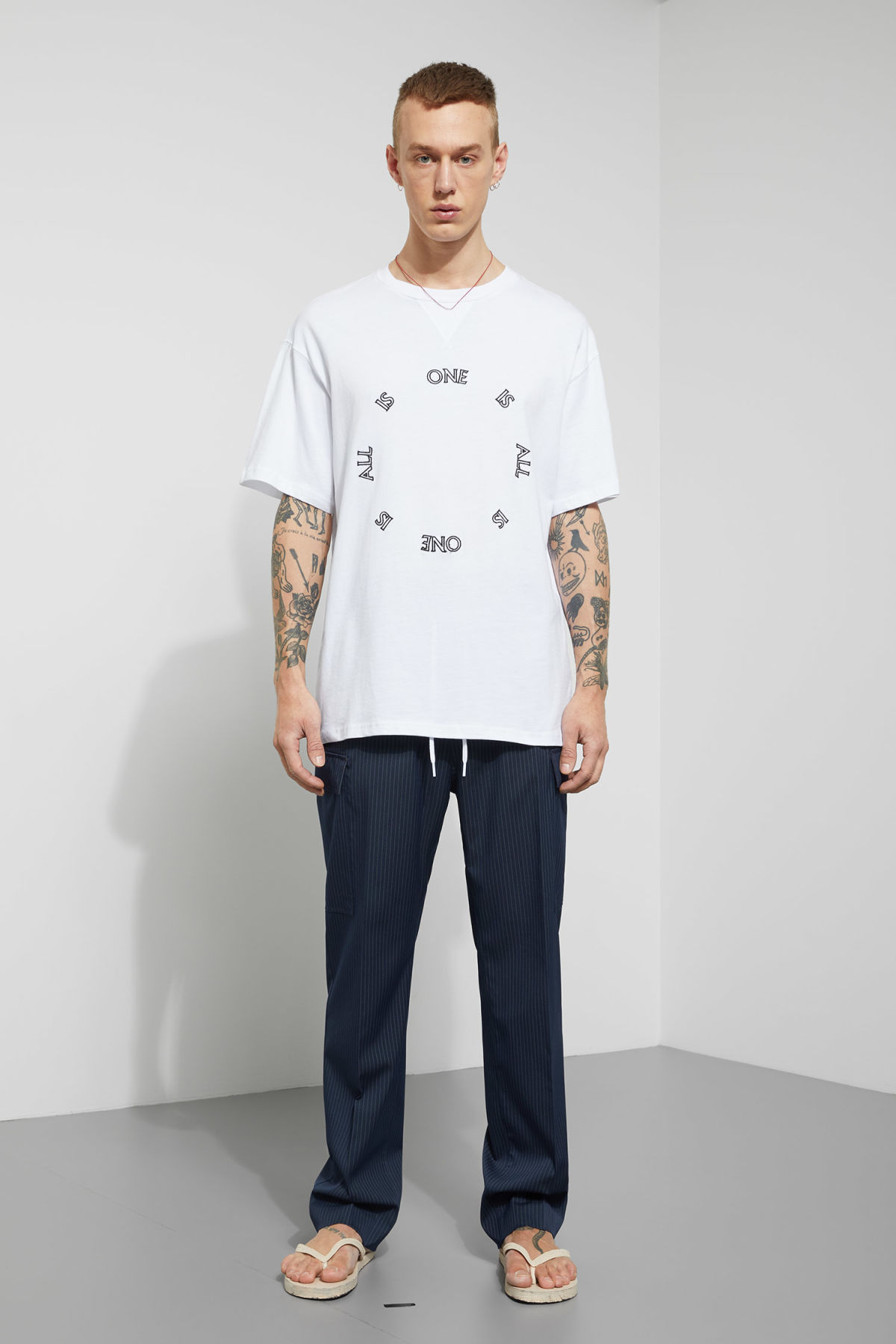 Model side image of Weekday treta one is all t-shirt  in white