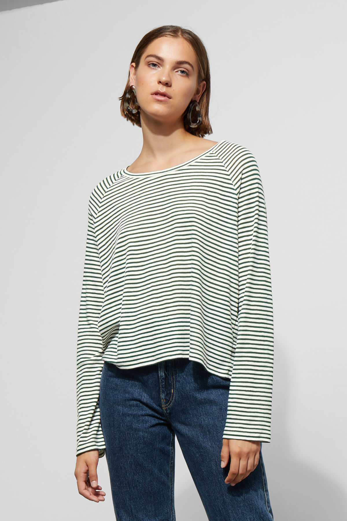 Model front image of Weekday base boxy long sleeve  in green