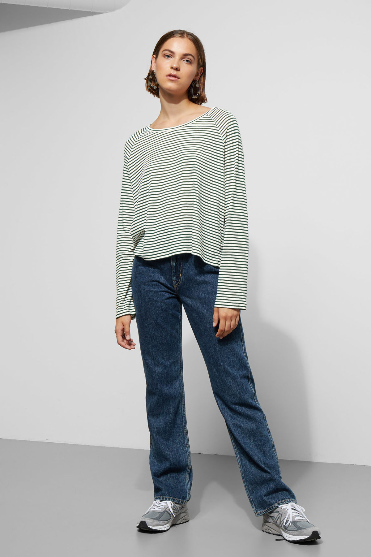 Model side image of Weekday base boxy long sleeve  in green