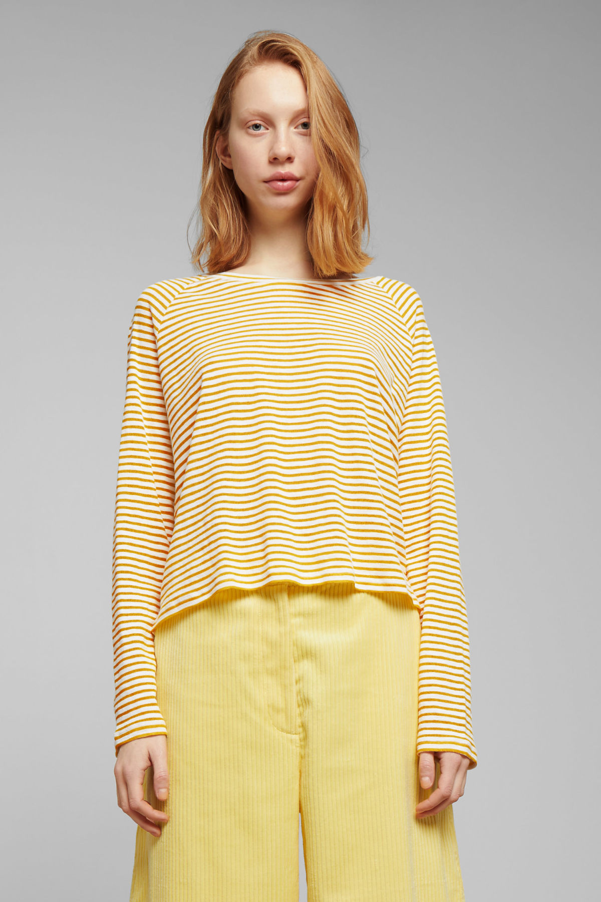 Model front image of Weekday base boxy long sleeve  in yellow