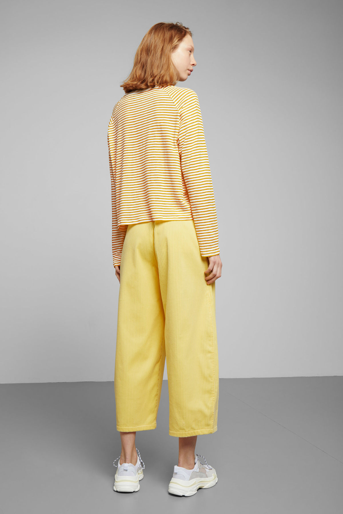 Model back image of Weekday base boxy long sleeve  in yellow