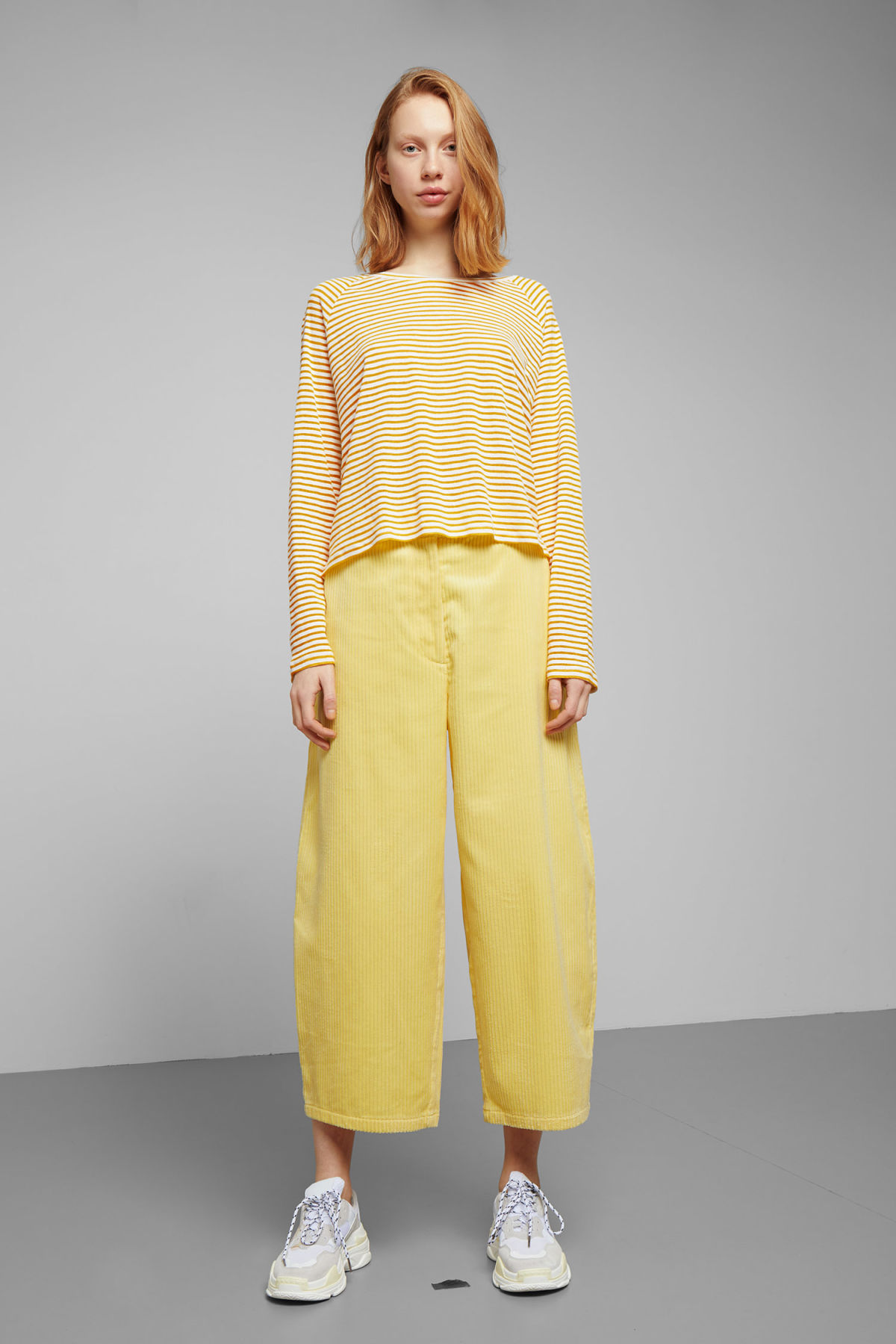 Model side image of Weekday base boxy long sleeve  in yellow