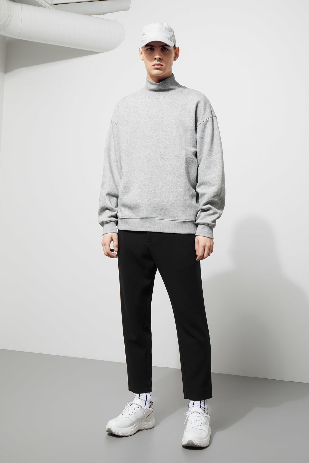 Model side image of Weekday big turtleneck sweatshirt in grey