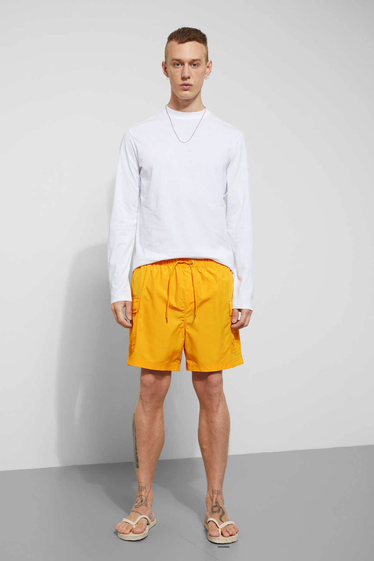 Model front image of Weekday cymbal swim shorts in yellow