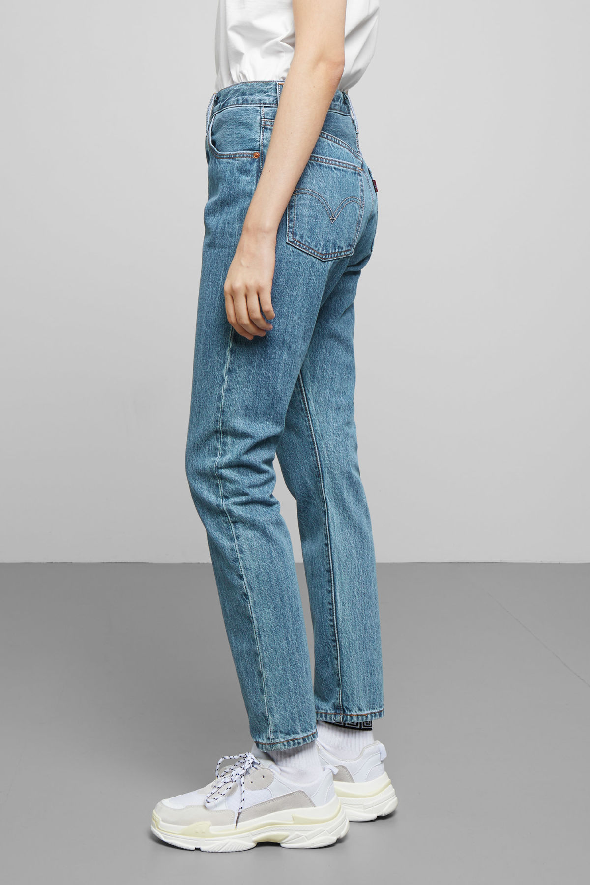 Model side image of Weekday 501 skinny rolling dice jeans in blue