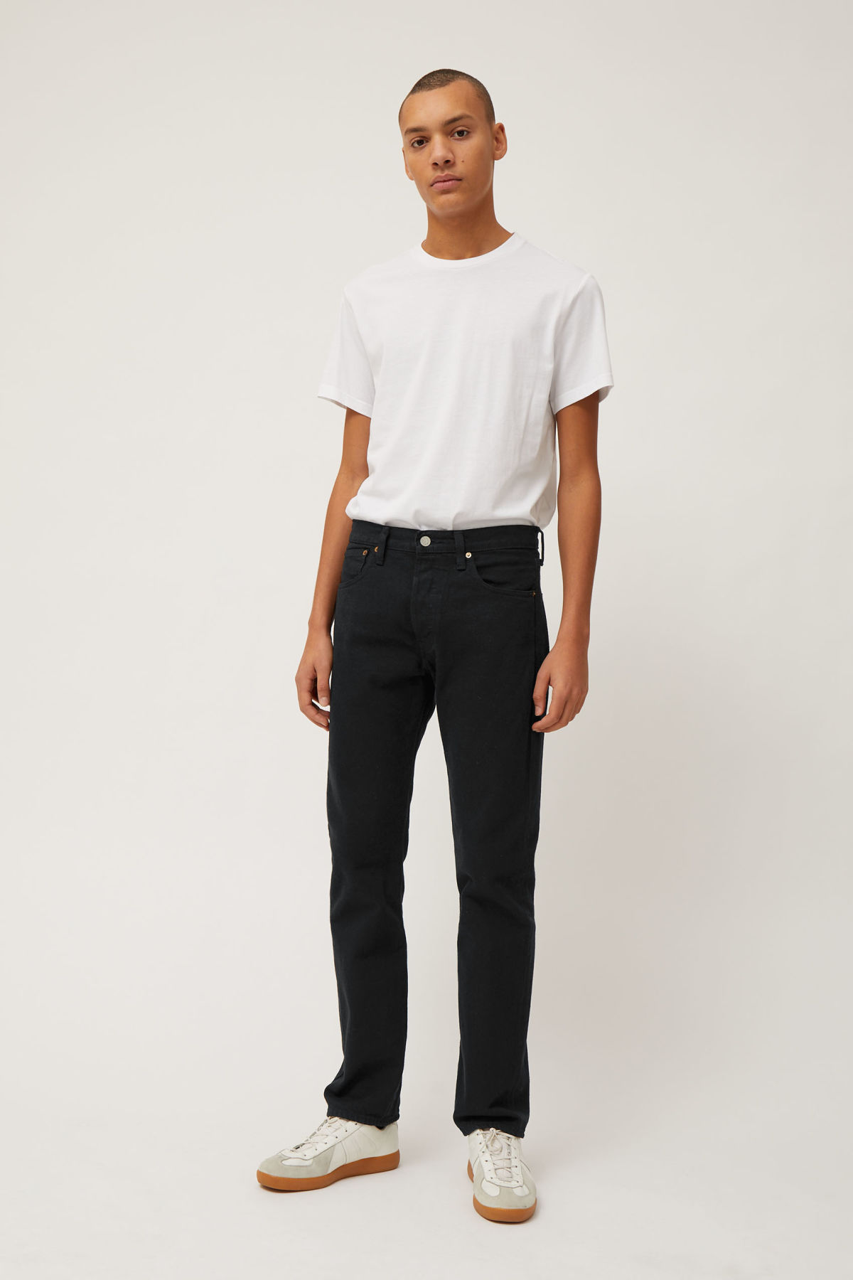 Model side image of Weekday 501 original black jeans in black