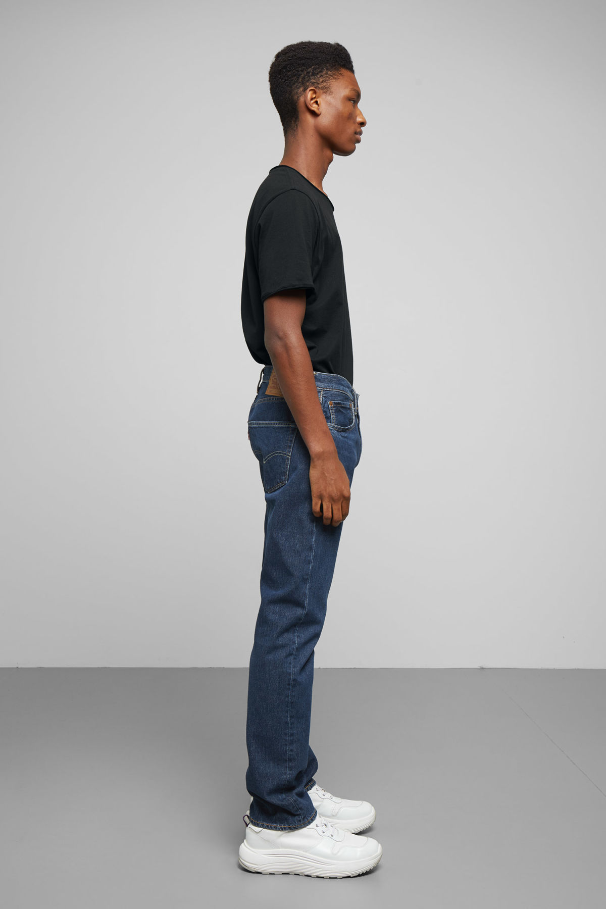 Model side image of Weekday 501 original sub station jeans in blue