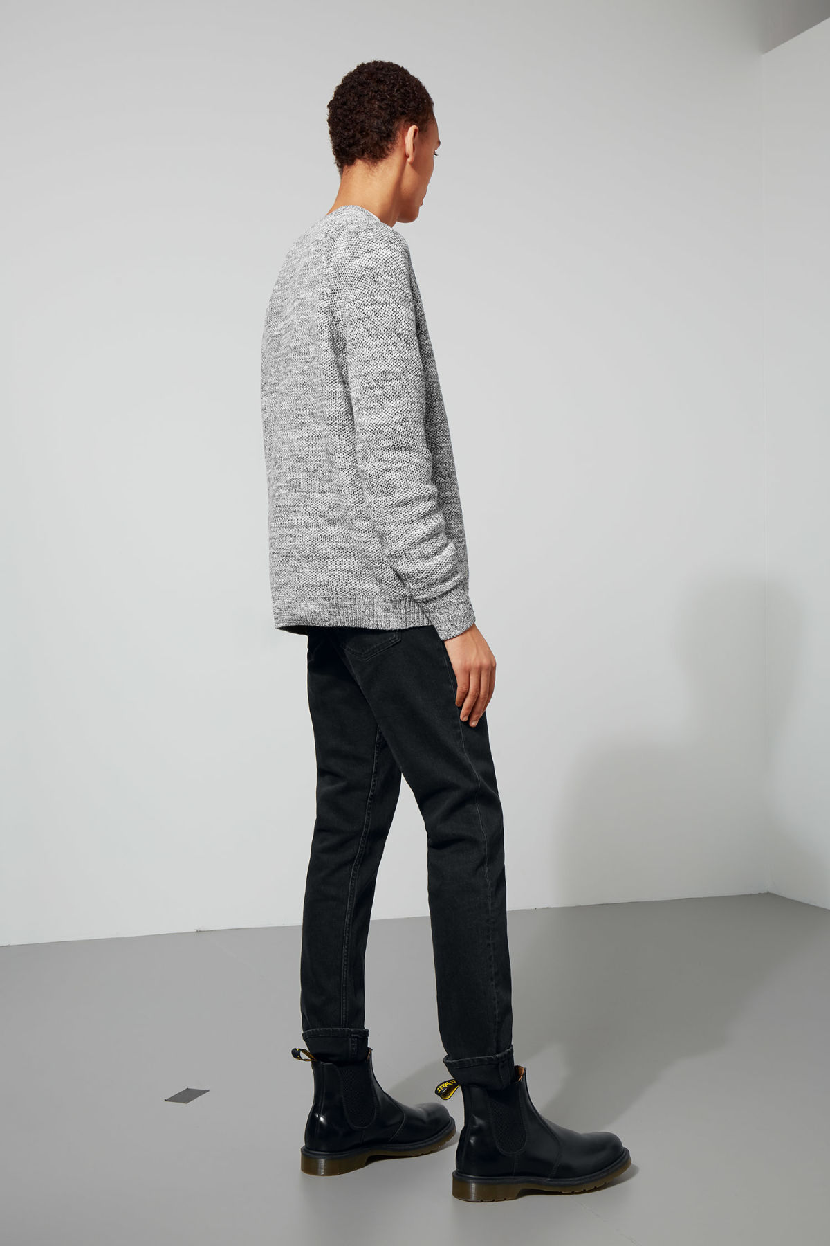 Model side image of Weekday cave sweater in black