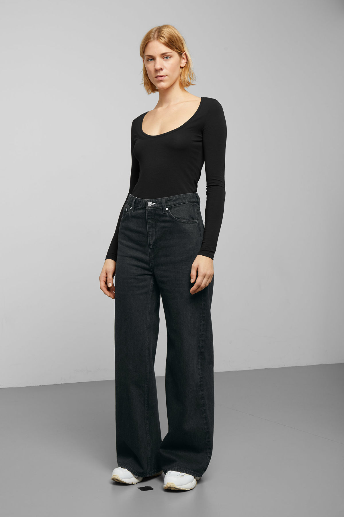 Model front image of Weekday ace tuned black jeans in black