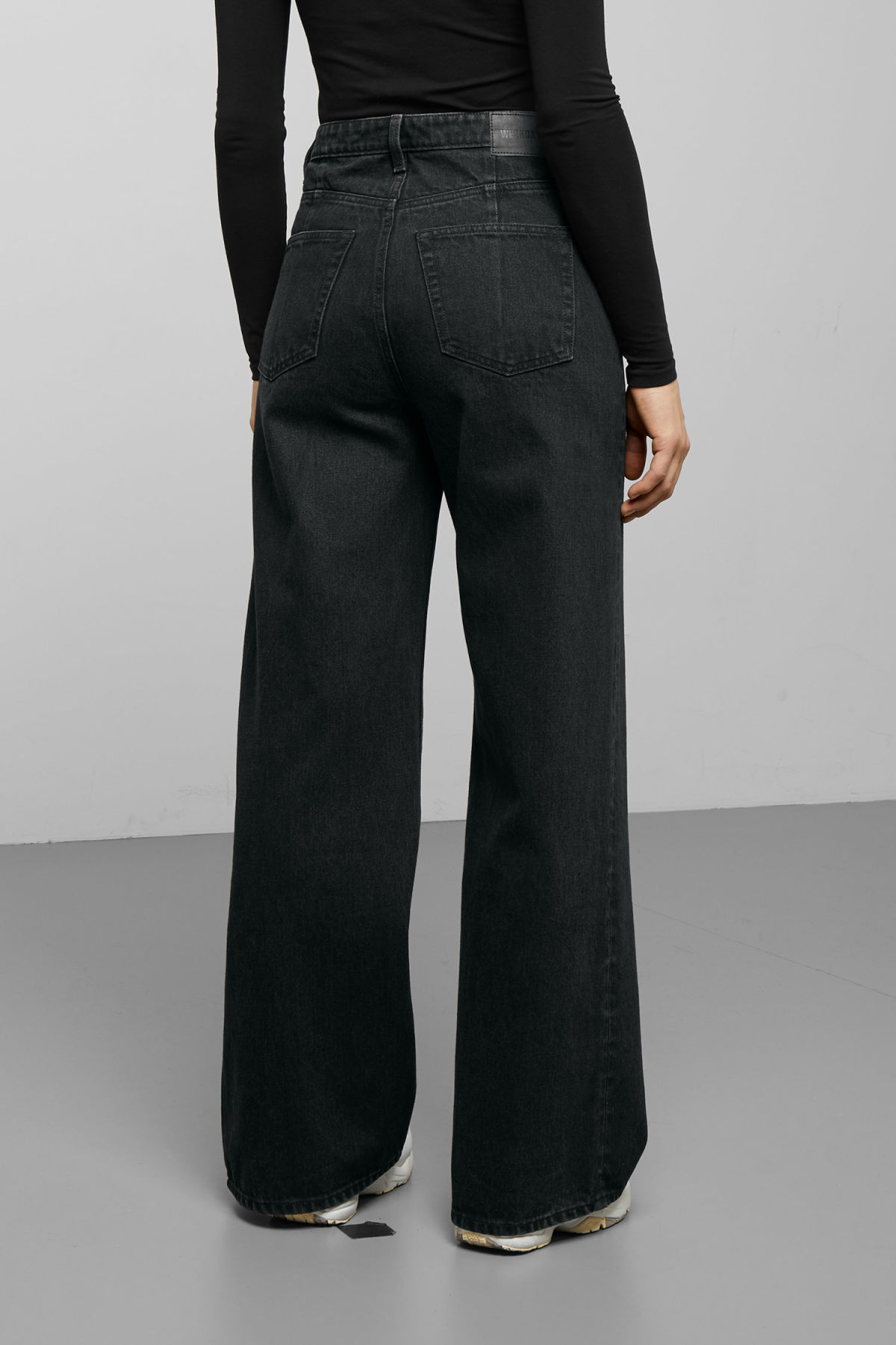 Model side image of Weekday ace tuned black jeans in black