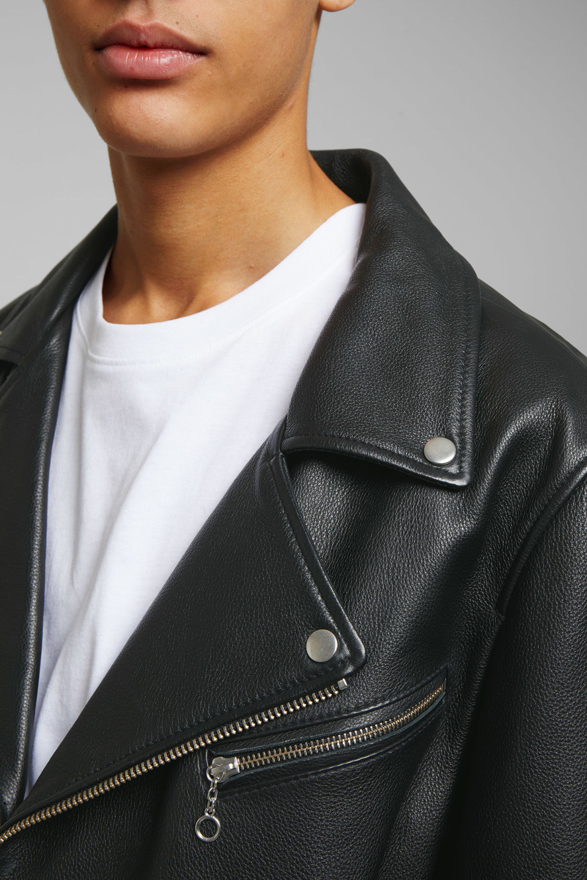 Model side image of Weekday biker leather jacket in black