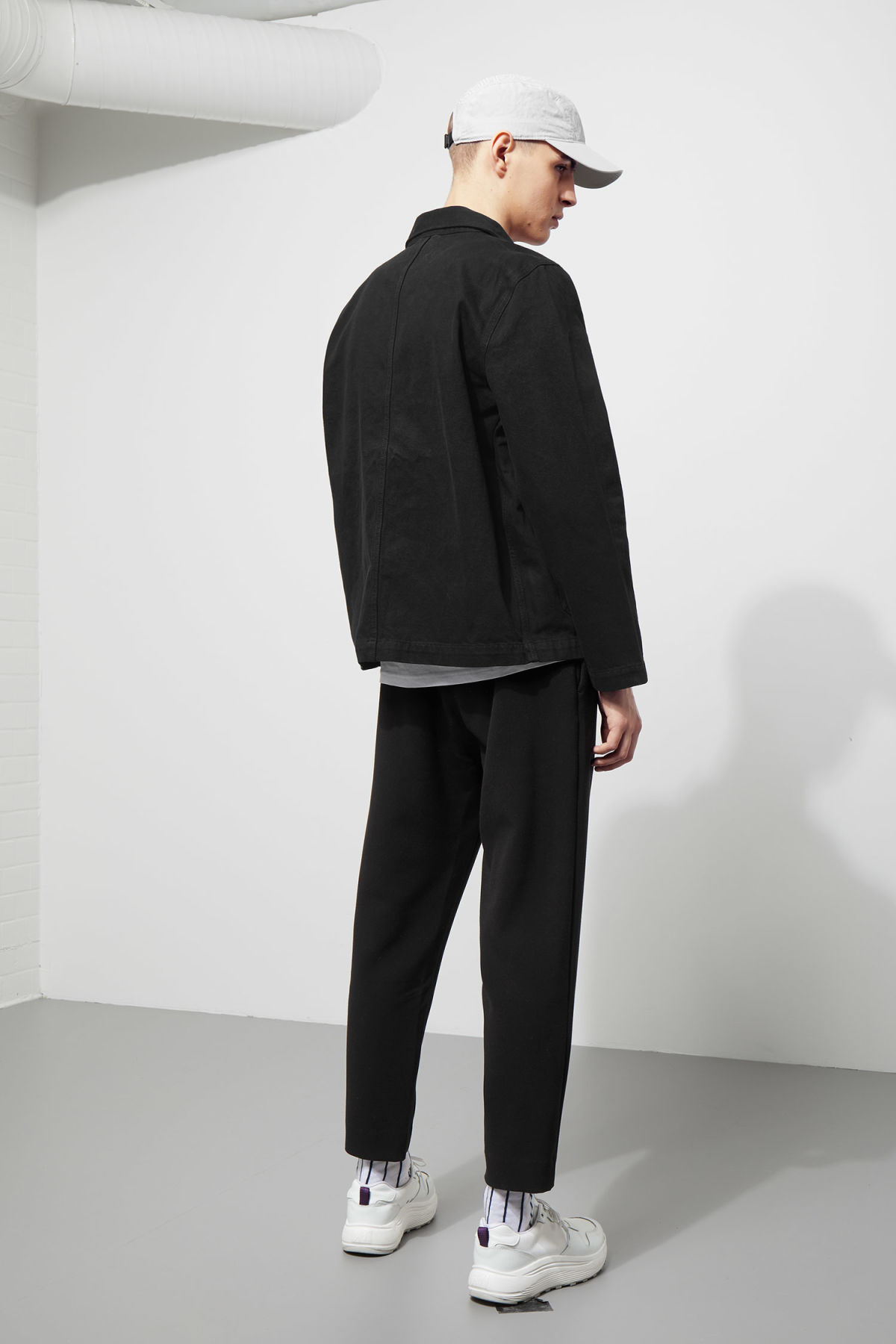 Model back image of Weekday generic od black jacket  in black