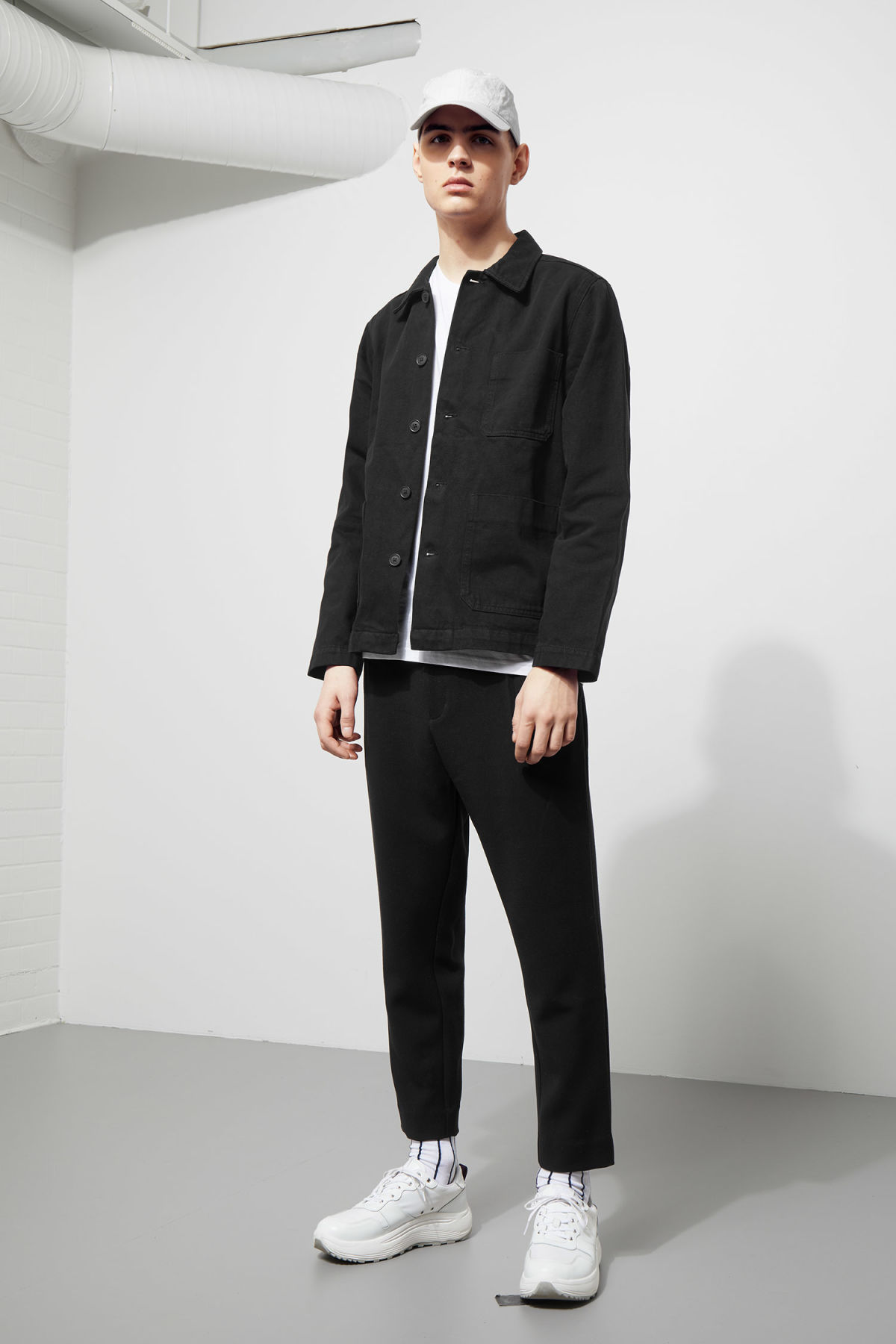 Model side image of Weekday generic od black jacket  in black