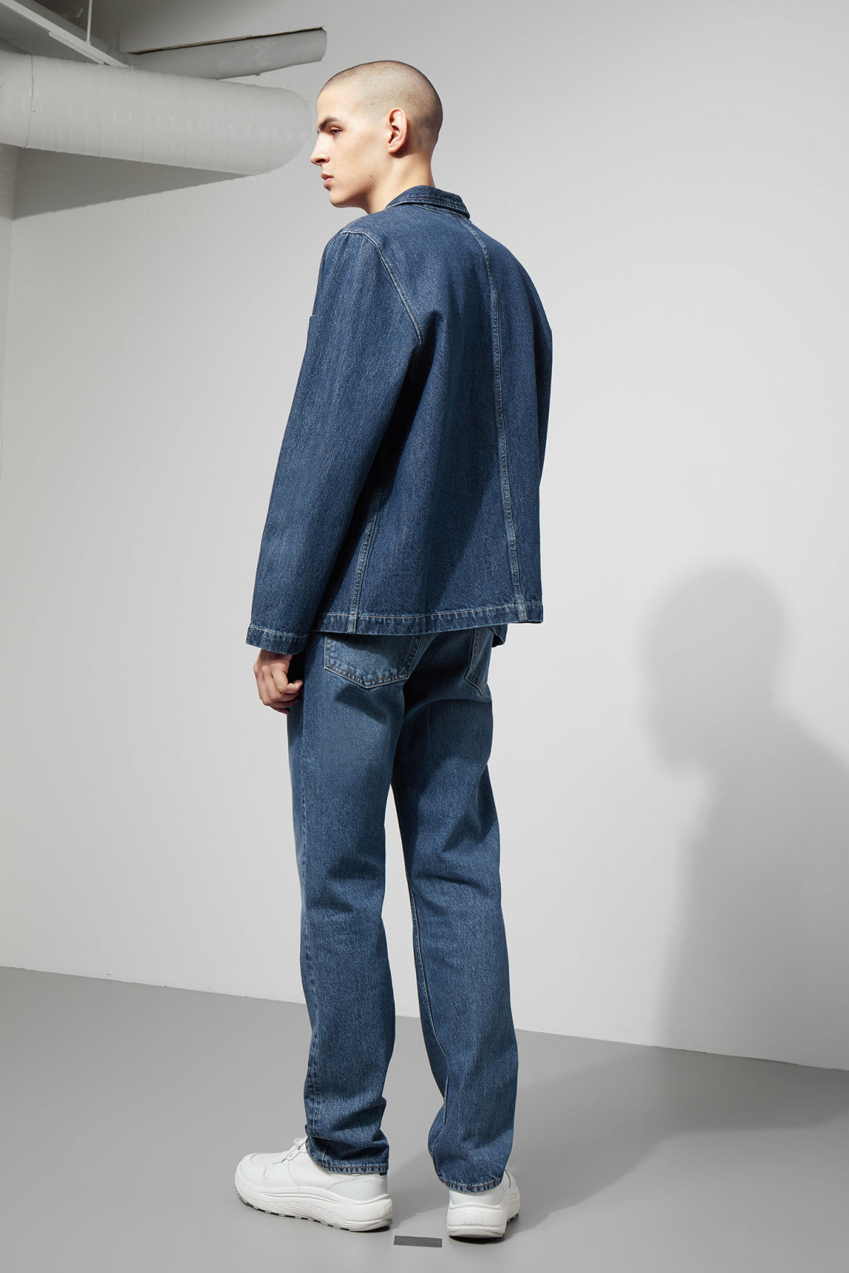 Model back image of Weekday generic denver blue jacket  in blue