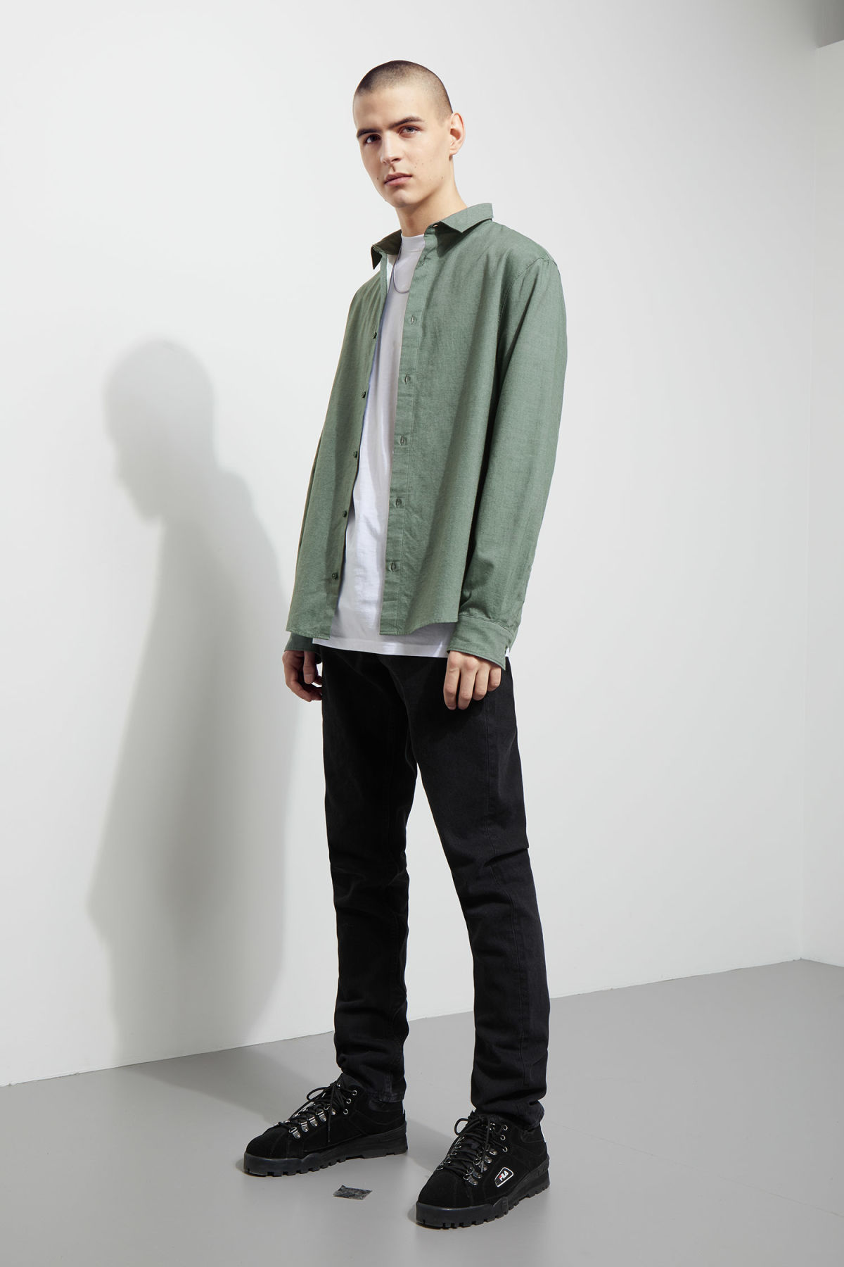 Model side image of Weekday pablo shirt in green
