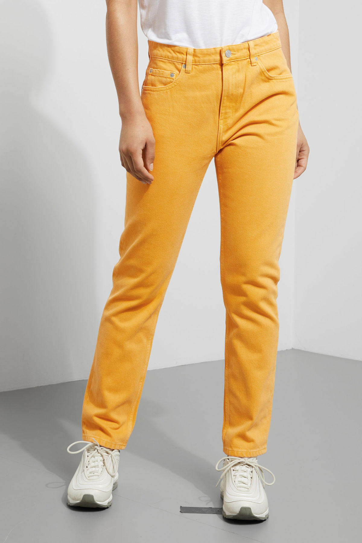 Model side image of Weekday seattle yellow jeans in yellow