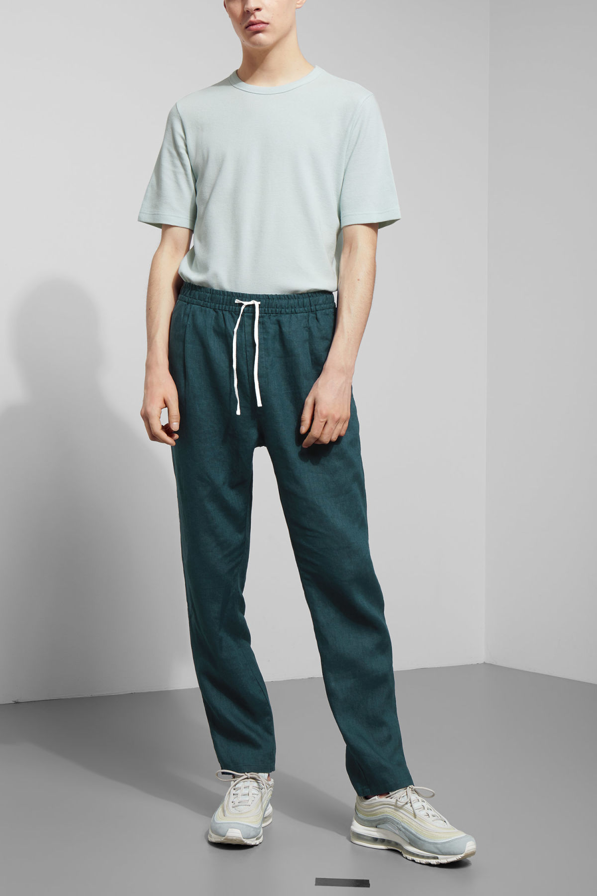 Model front image of Weekday malba linen trousers in turquoise