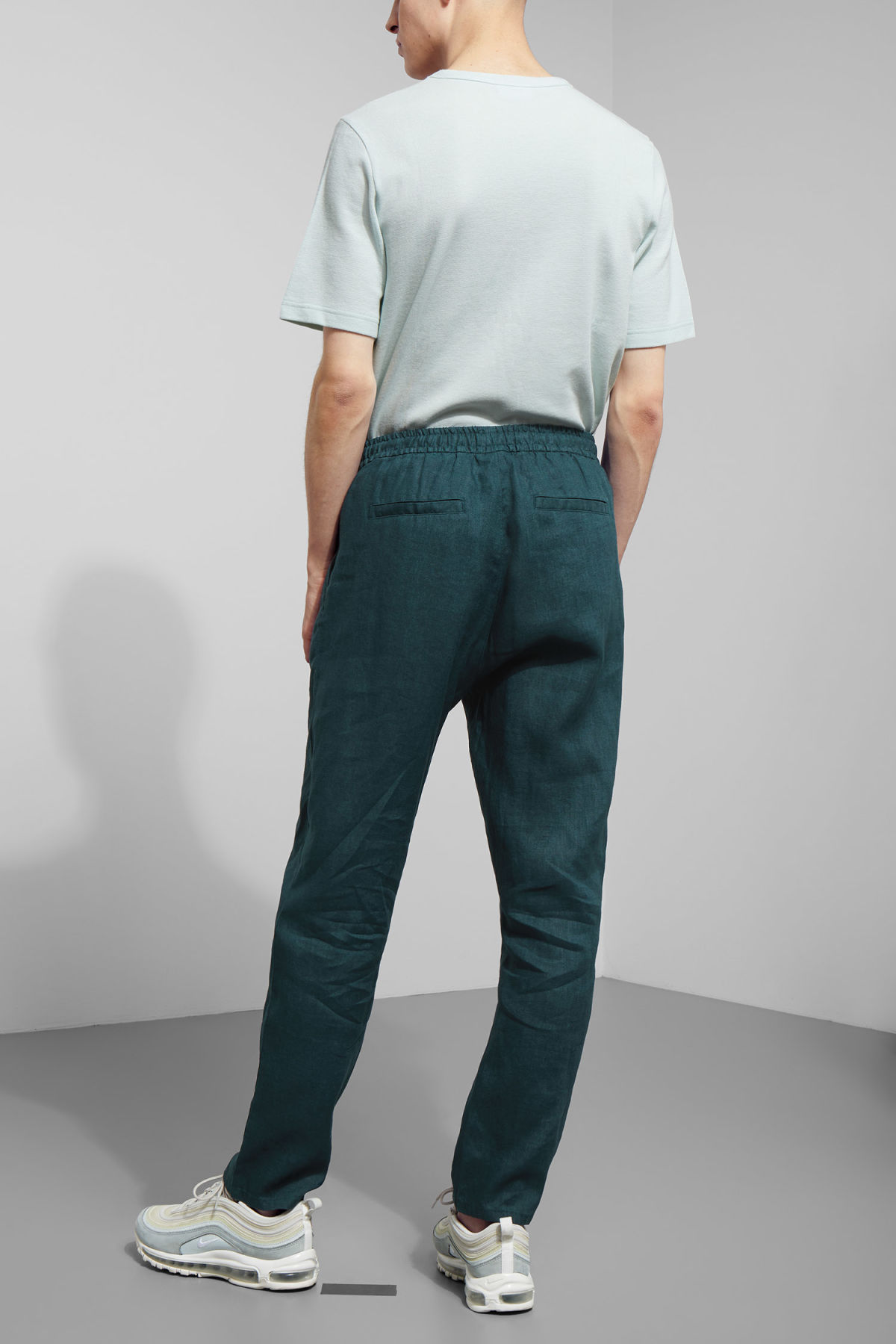 Model back image of Weekday malba linen trousers in turquoise