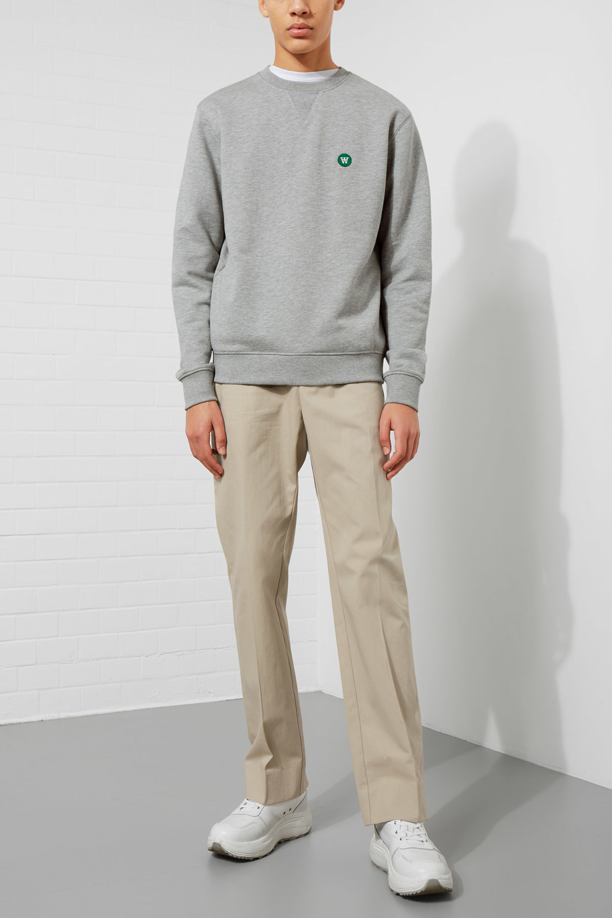 Model side image of Weekday tye sweatshirt in grey