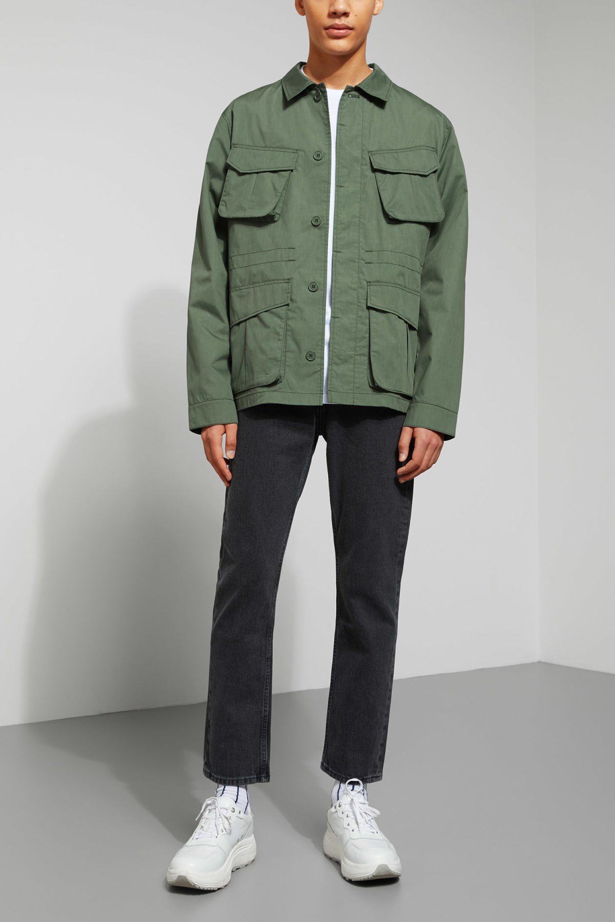 Model side image of Weekday keith pocket jacket in green