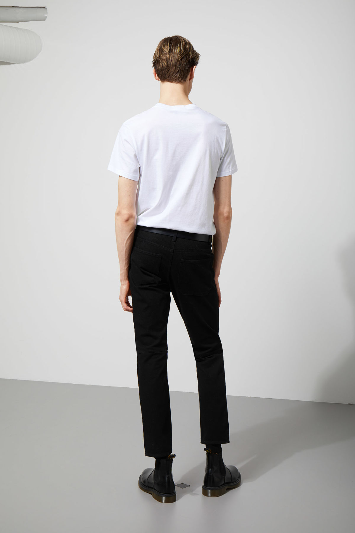 Model side image of Weekday grime trousers in black