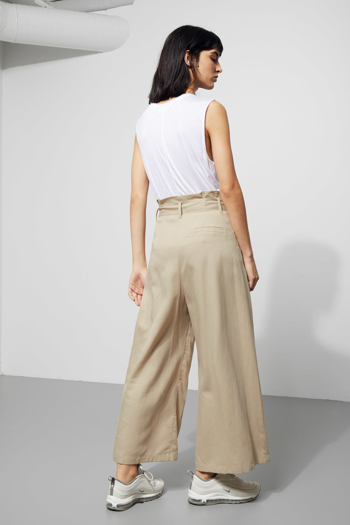 Model back image of Weekday mucha trousers in beige