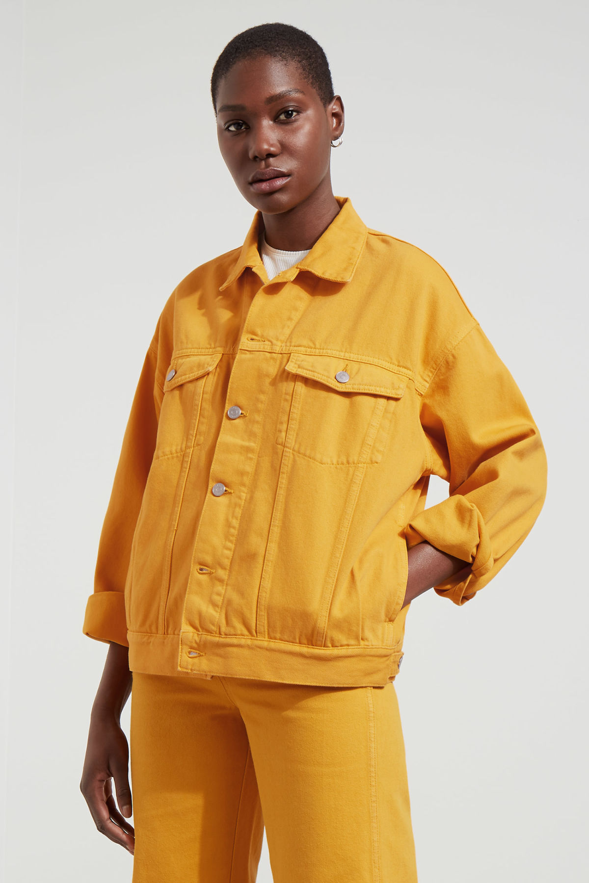 Model front image of Weekday dune yellow jacket  in yellow