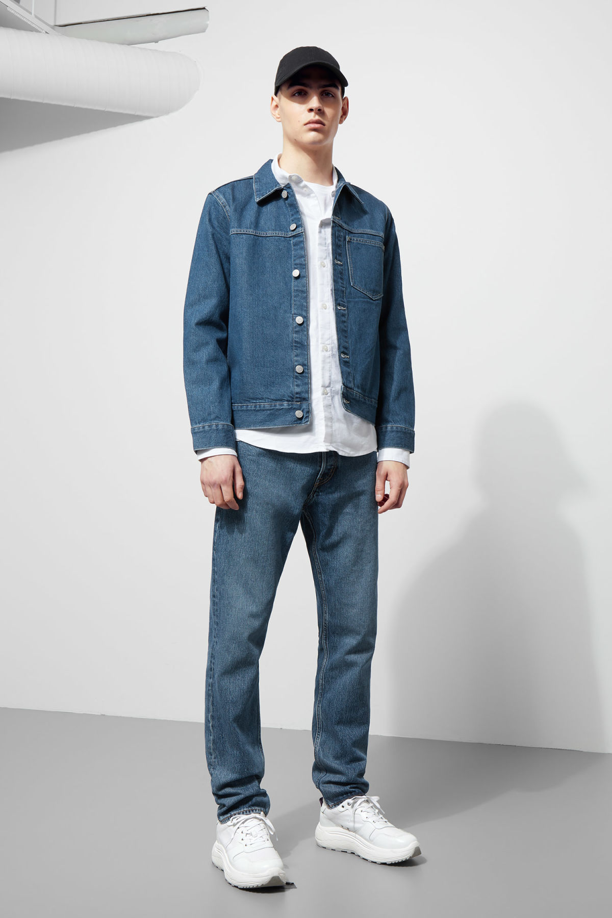 Model side image of Weekday core laver blue denim jacket  in blue