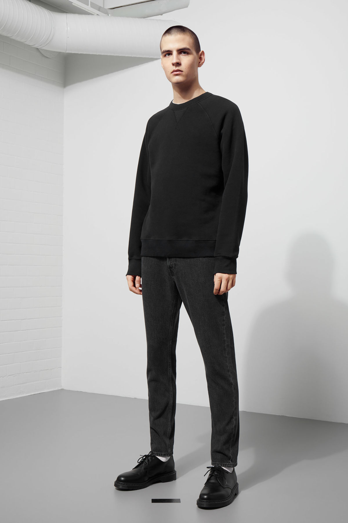Model side image of Weekday jaxon worn sweatshirt in black