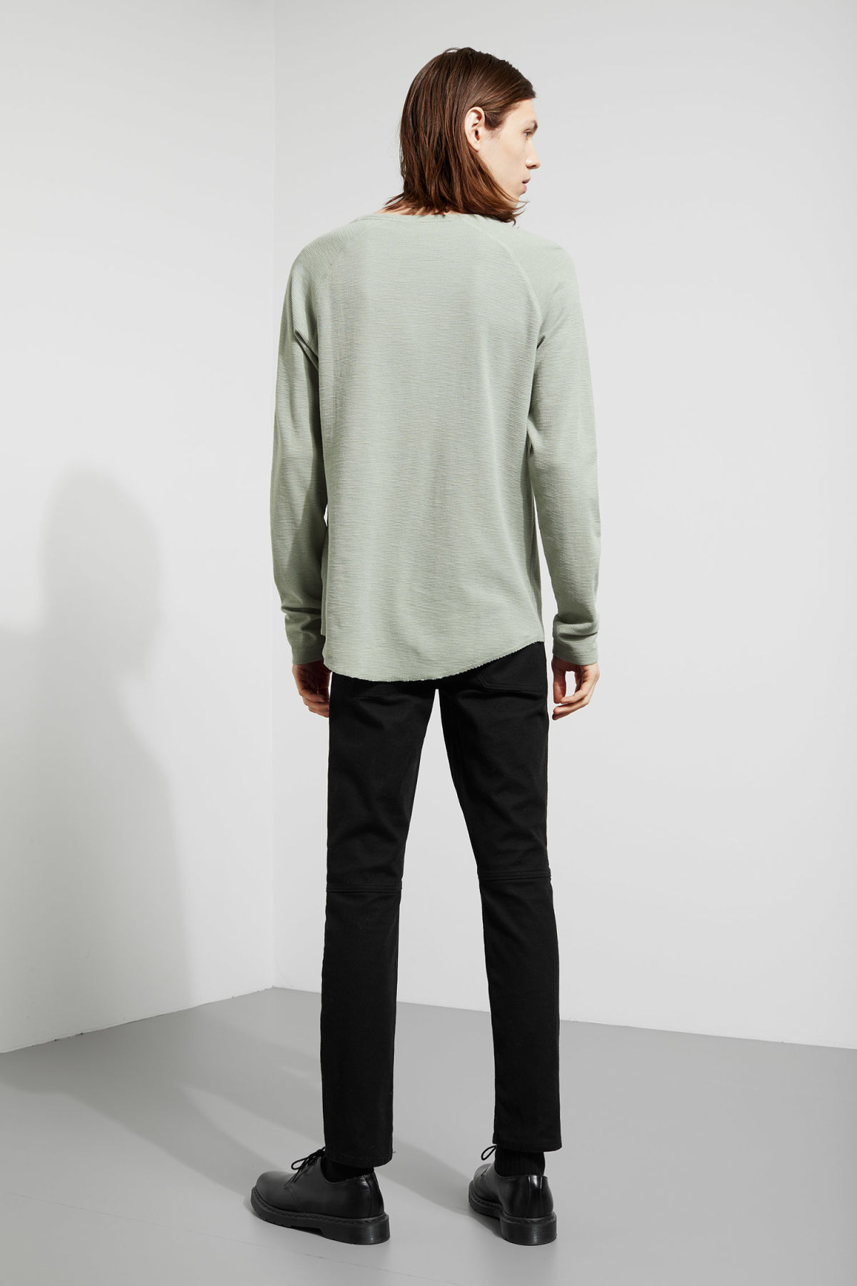 Model side image of Weekday zic waffle long sleeve in green