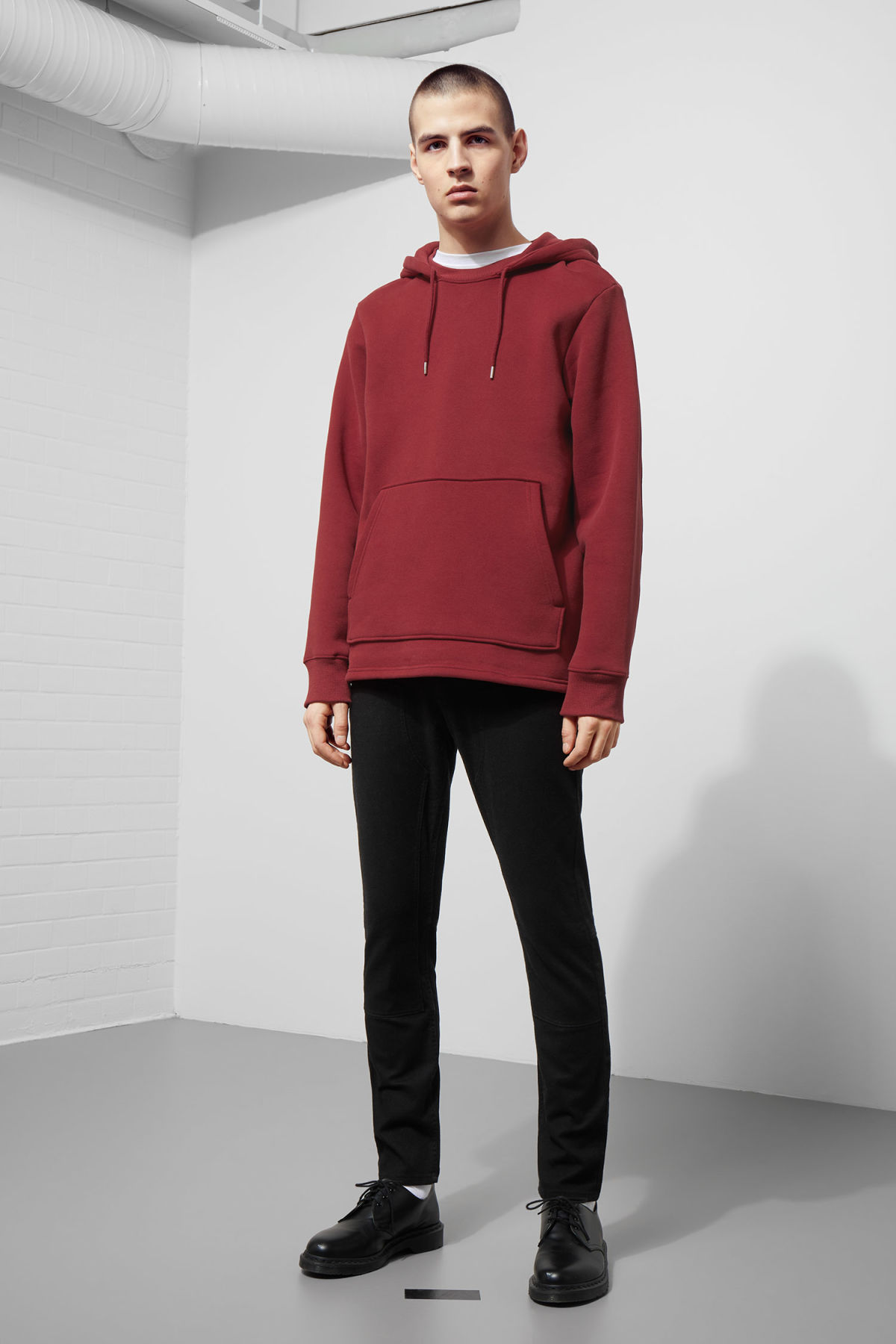 Model side image of Weekday troupe hoodie in red
