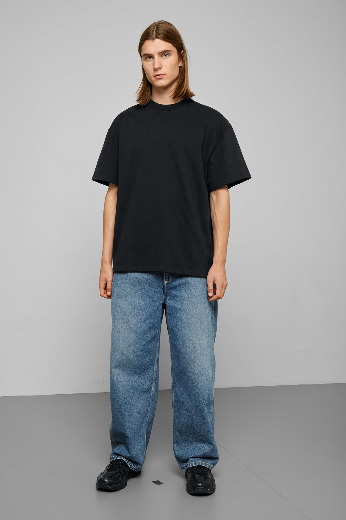 Model side image of Weekday great t-shirt in black