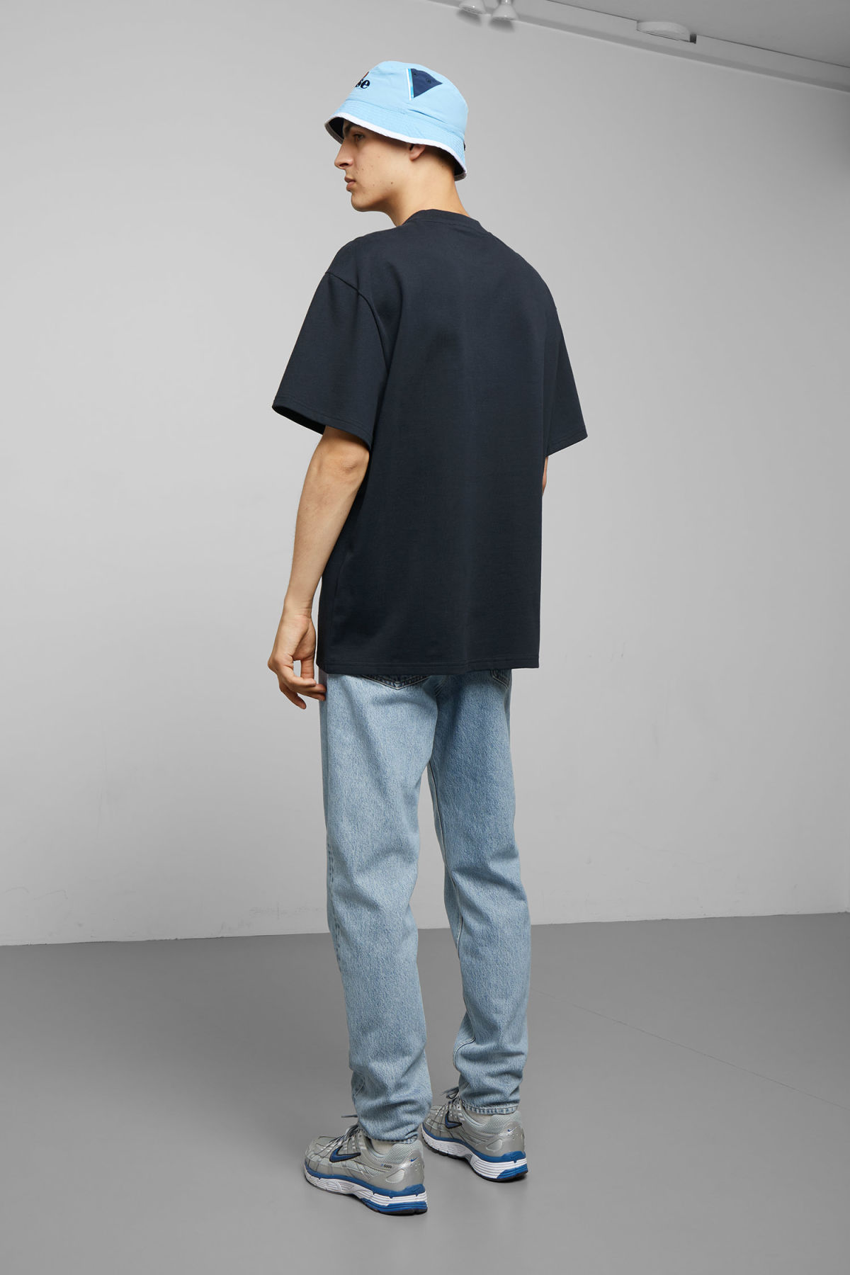 Model side image of Weekday great t-shirt in blue