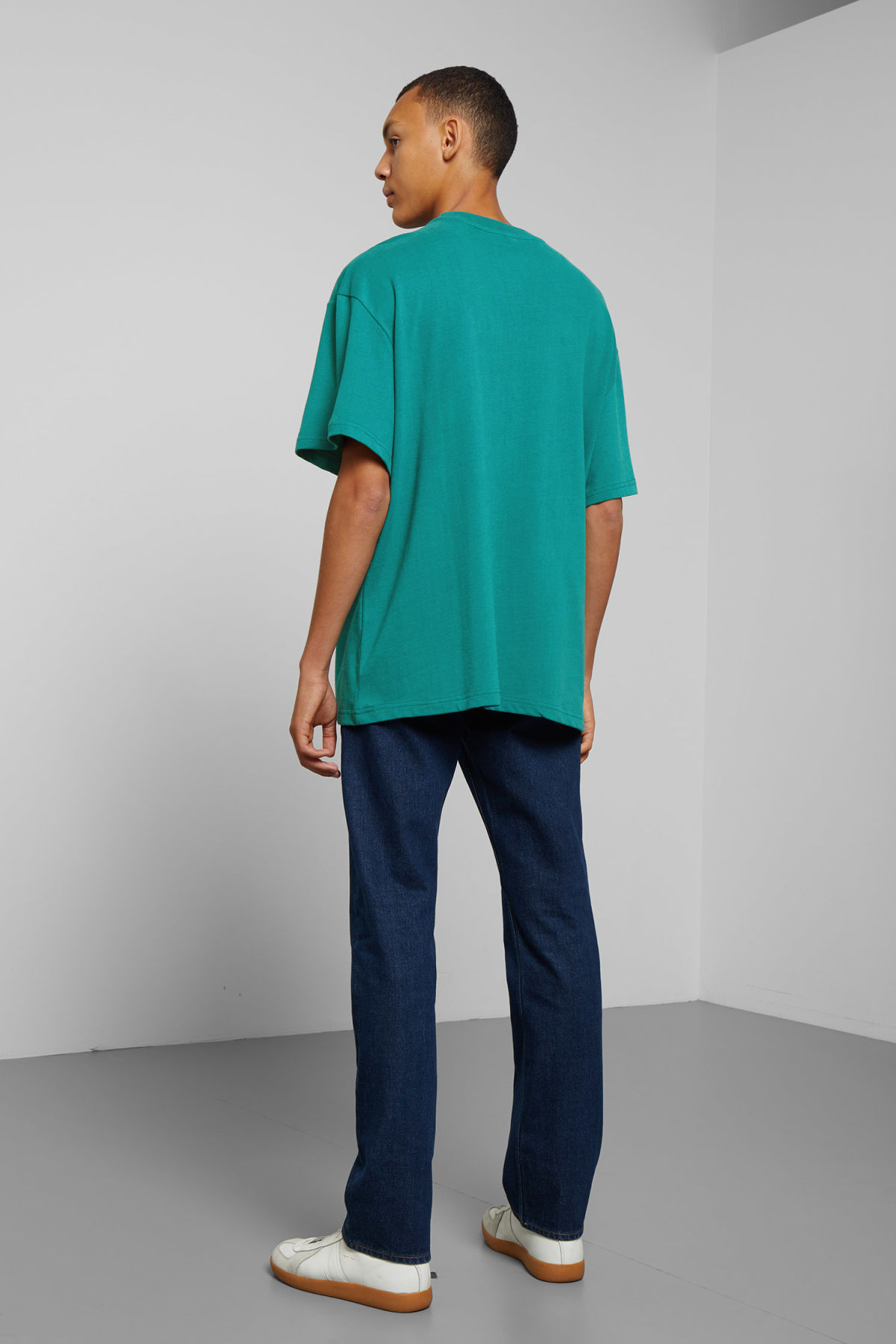 Model side image of Weekday great t-shirt in turquoise