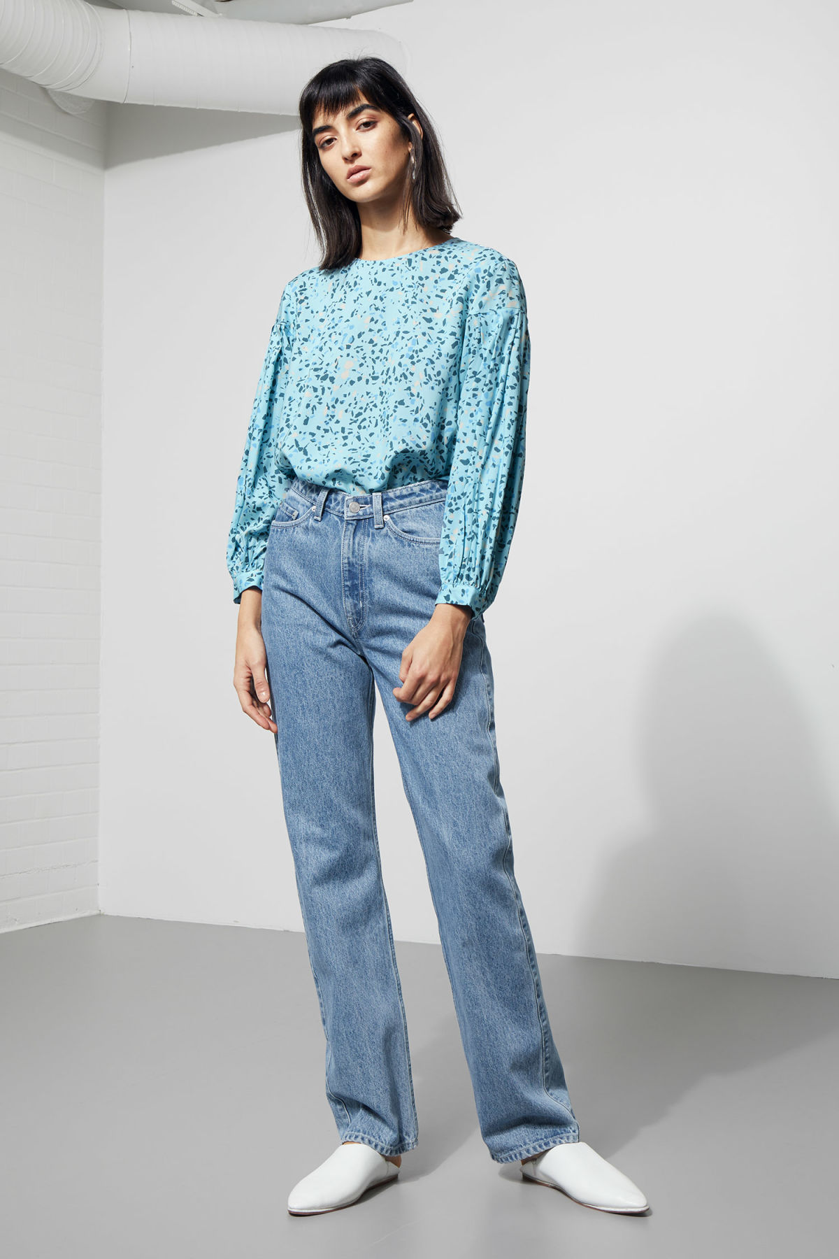 Model side image of Weekday savina blouse in blue
