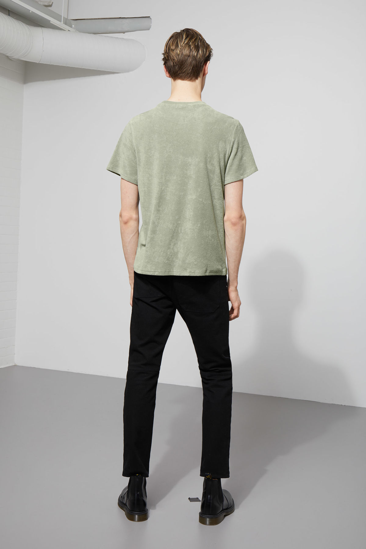 Model side image of Weekday towel t-shirt in green