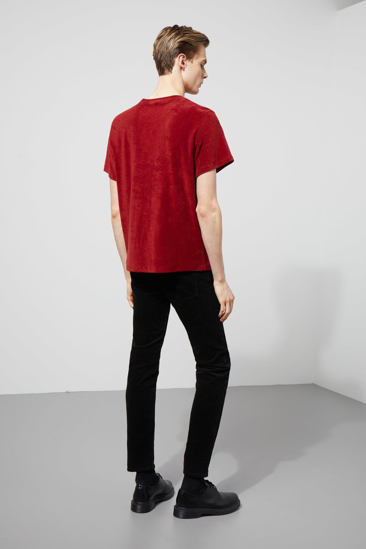 Model side image of Weekday towel t-shirt in red