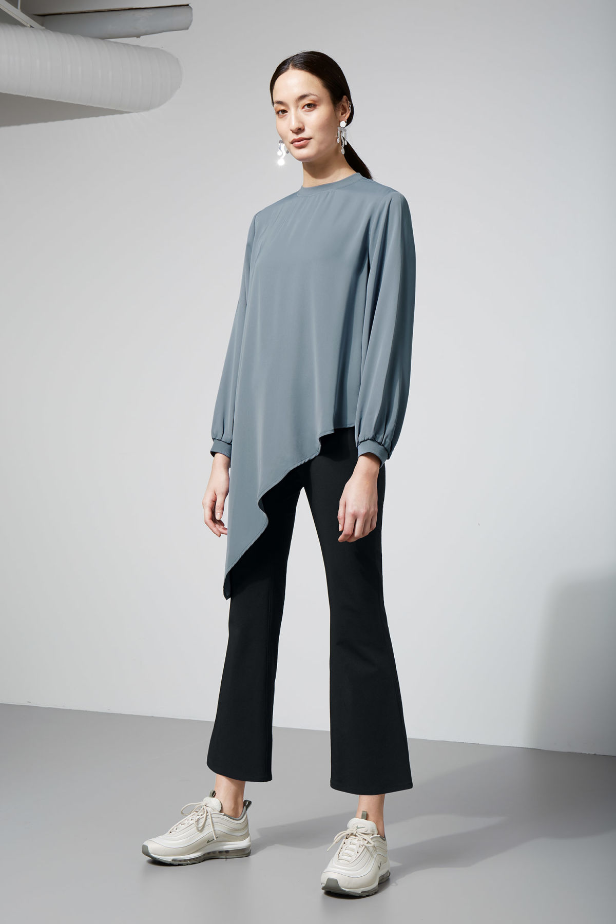 Model side image of Weekday clemence blouse in blue
