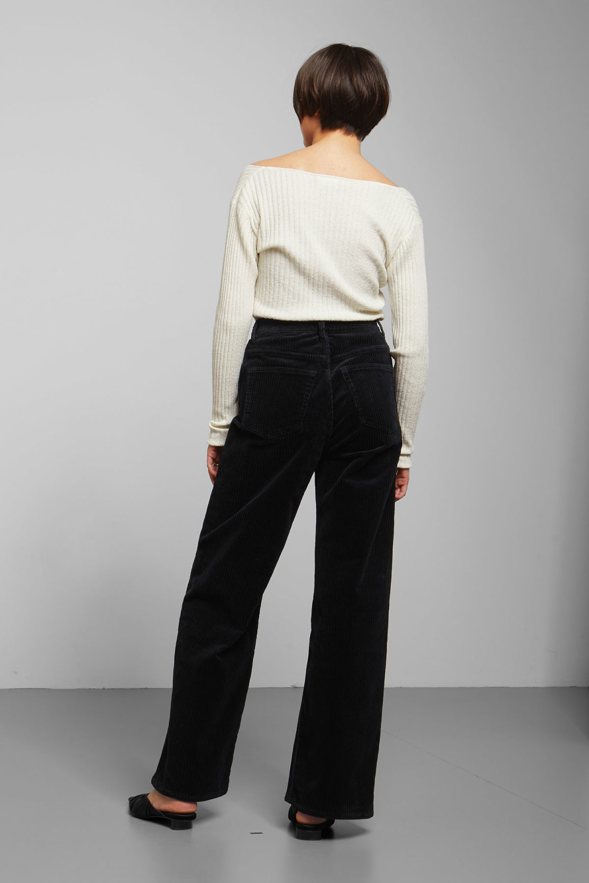Model back image of Weekday ace corduroy trousers in black