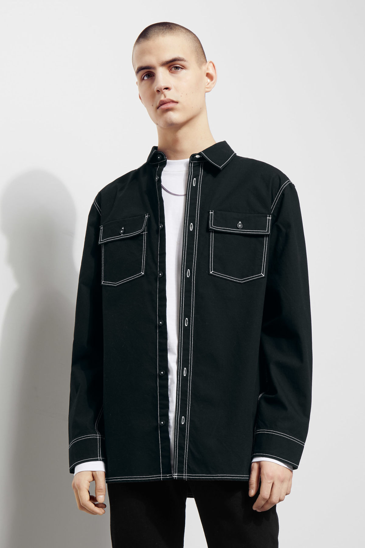 Model side image of Weekday deft shirt in black