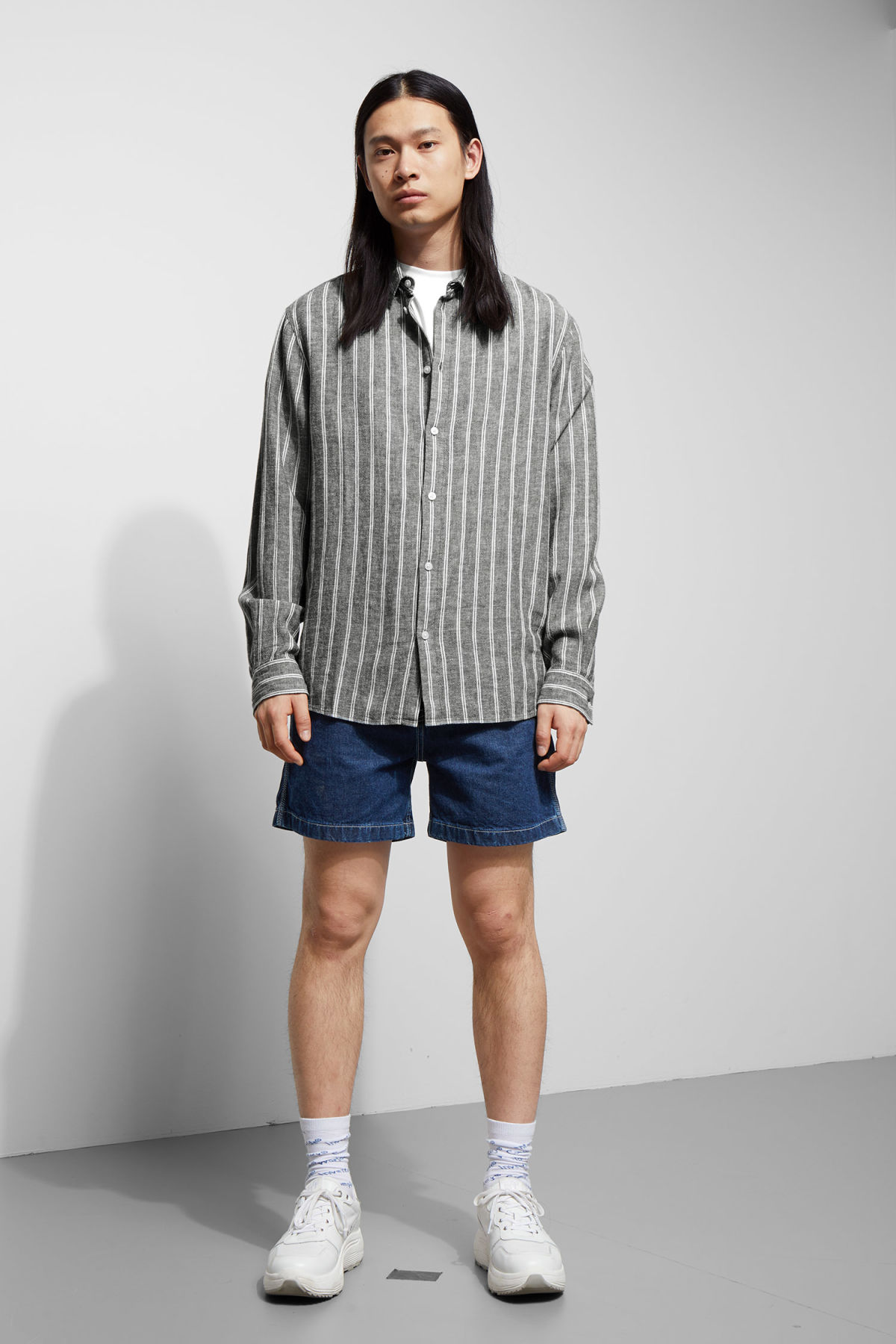 Model side image of Weekday lead striped shirt in blue