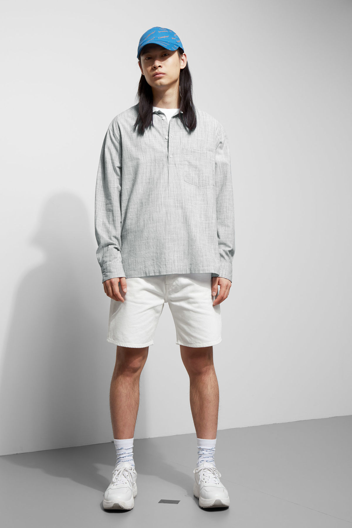 Model side image of Weekday vito striped shirt in white
