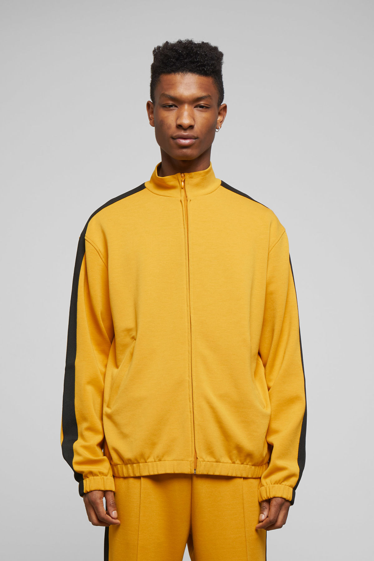 Model front image of Weekday track sweatshirt  in yellow