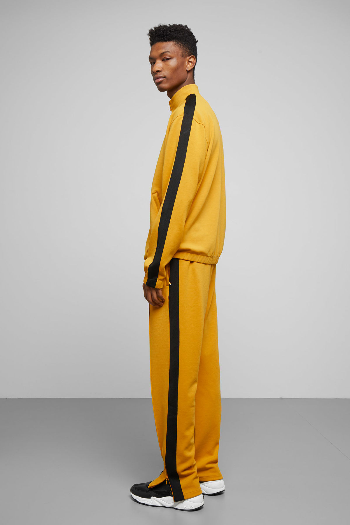 Model side image of Weekday track sweatshirt  in yellow