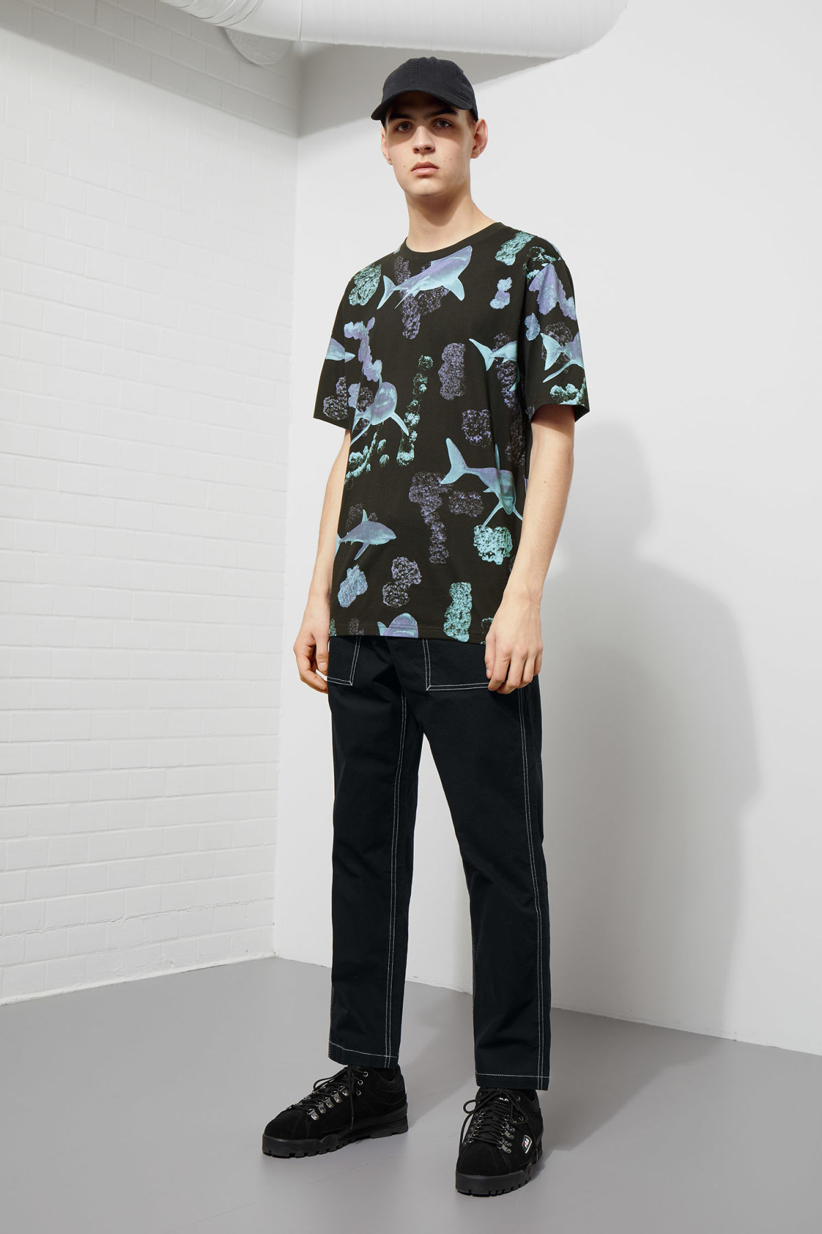 Model side image of Weekday frank coral t-shirt in black