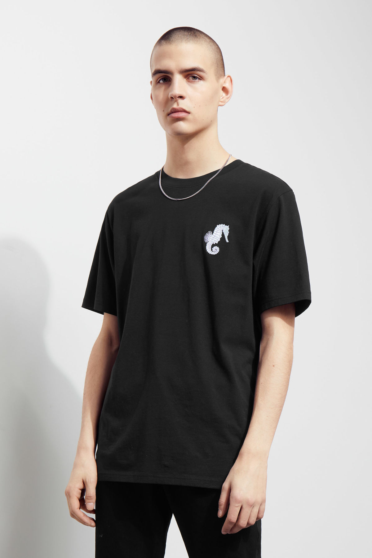 Model side image of Weekday frank seahorse t-shirt in black