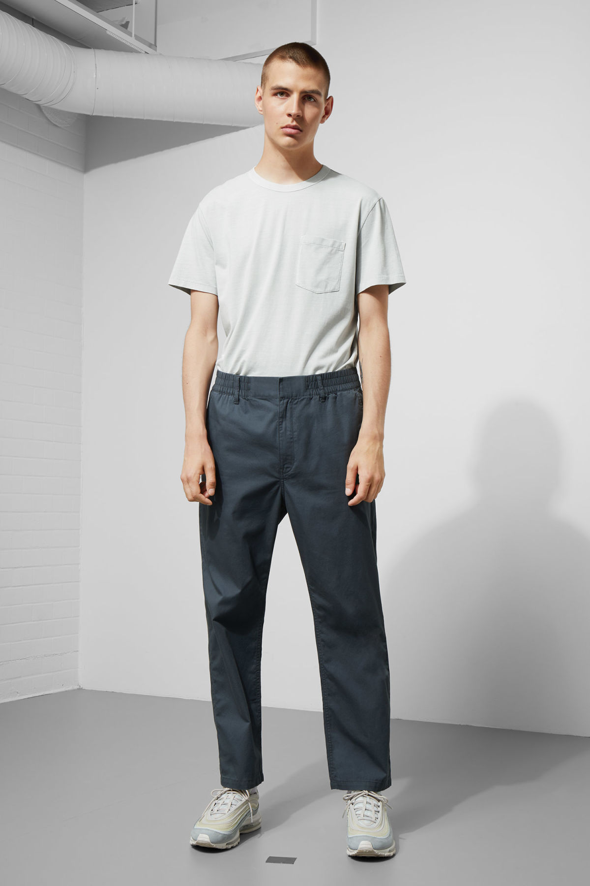 Model front image of Weekday bosse trousers in blue